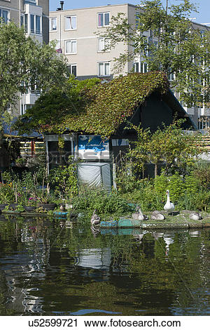 Stock Photography of Floating cottage with plants u52599721.