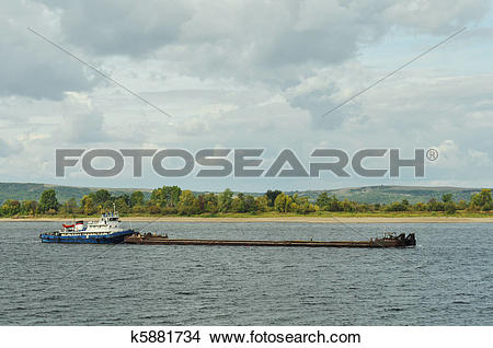 Stock Photo of Ship and cargo floating platform, water transport.