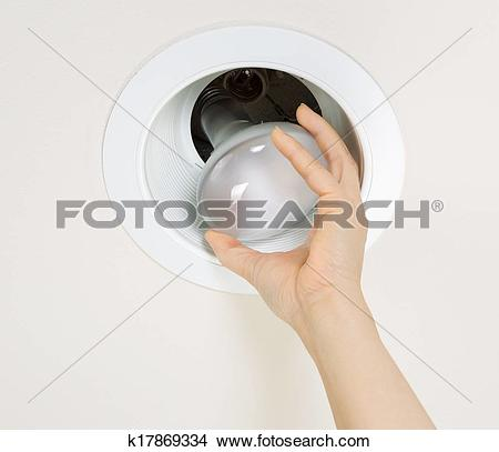 Stock Photo of Removing Old Flood Light Bulb k17869334.