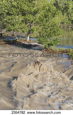 Stock Photo of Flowing Water In A Flooded River; Calgary, Alberta.