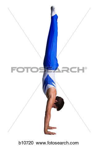 Stock Photography of Male gymnast doing floor exercises b10720.