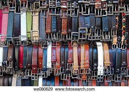 Stock Photograph of Belts for sale at fle market, Florence. Italy.