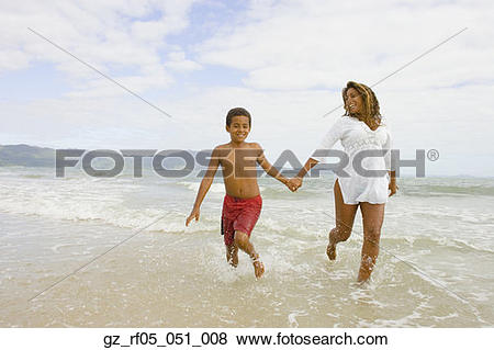 Pictures of African mother and son running in the surf.