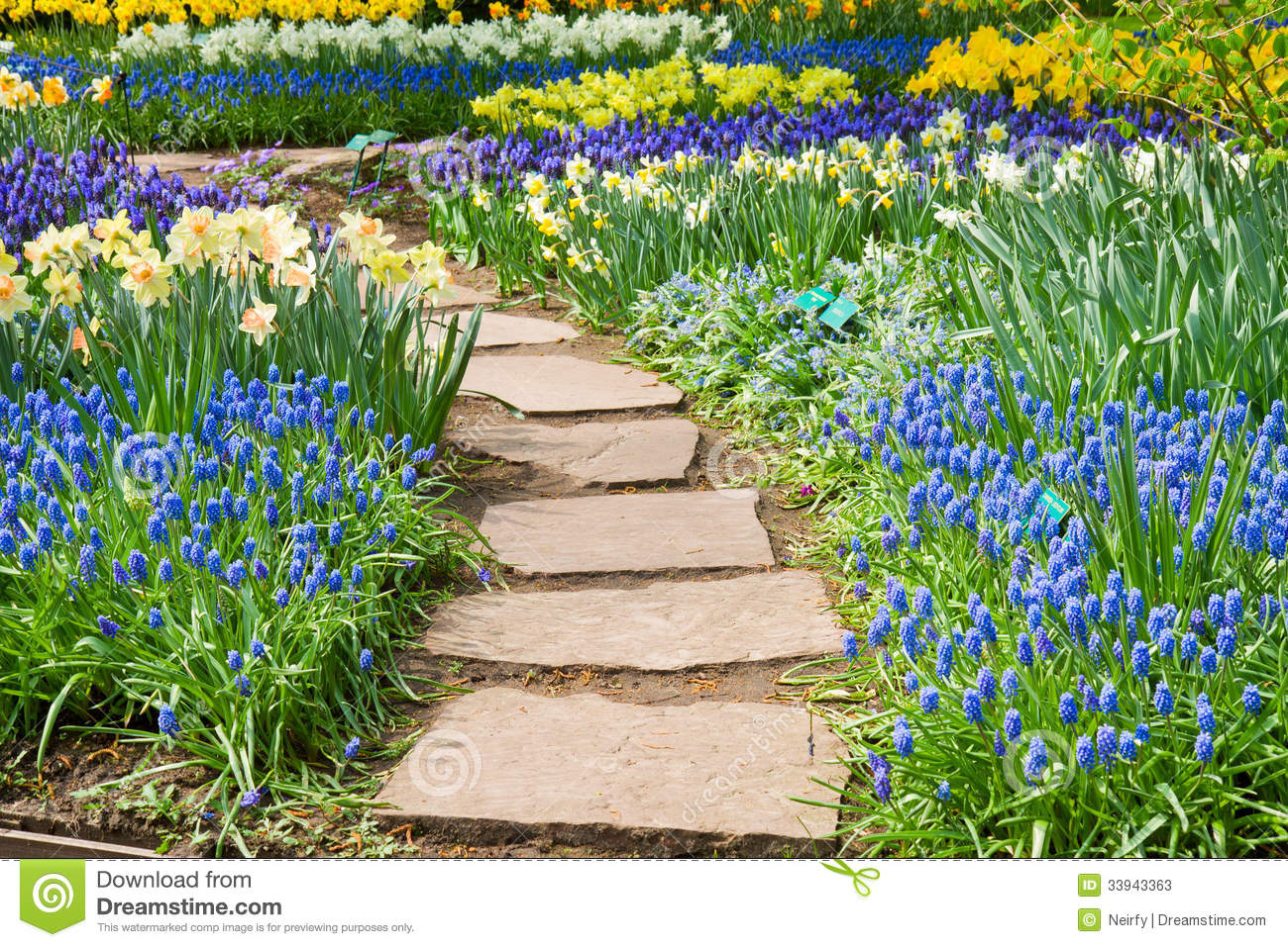 Stone Path Winding In A Garden Stock Photos.