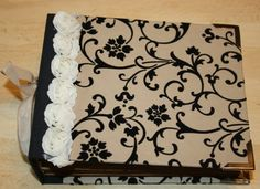How about creating a custom guestbook cover with the monogram we.