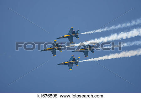 Pictures of The Blue Angels preform a diamond formation flyby.