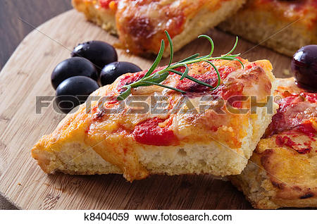 Stock Photograph of Focaccia with tomato and black olives.