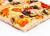 Stock Photo of focaccia with tomatoes, olives, artichokes and.