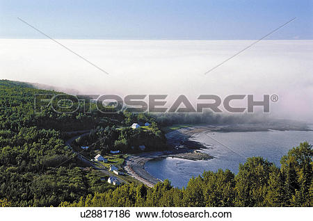 Stock Images of Fog bank rolls in along the rugged north shore of.