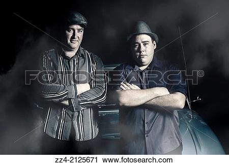 Stock Photography of 1950s portrait of 2 tough serious gangster.