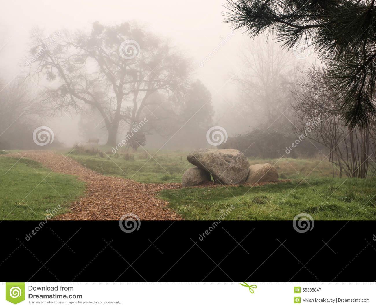 A Path Through A Park On A Foggy Day Stock Photo.