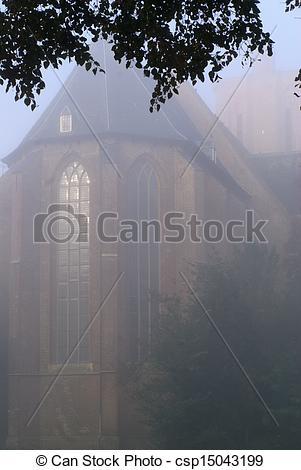 Stock Illustration of Foggy morning around the church in Elburg.