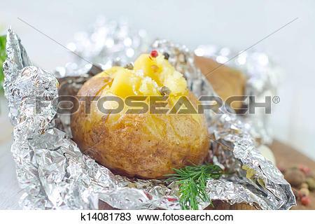 Stock Photo of baked potato in foil k14081783.