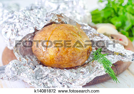 Stock Photo of baked potato in foil k14081872.