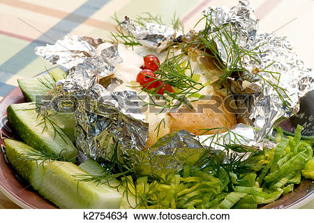 Stock Photo of potatoes in the skin, baked in foil k2754634.