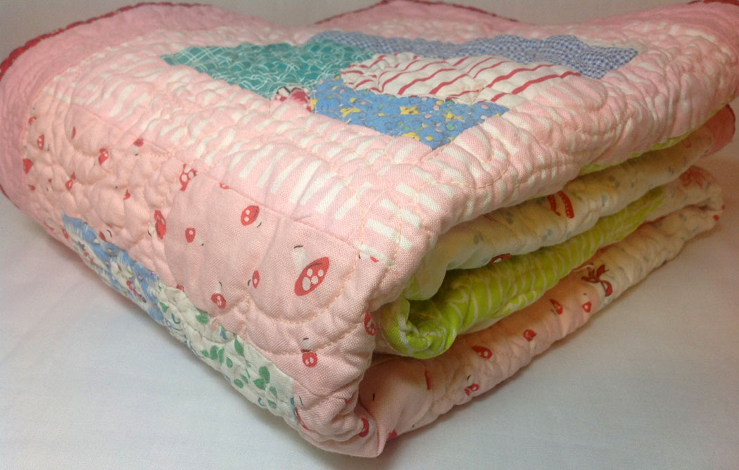 Folded quilt clipart.