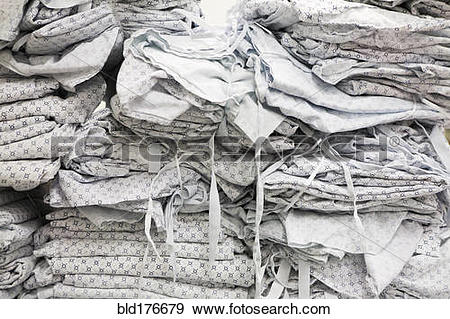 Stock Photograph of Close up of folded hospital gowns bld176679.