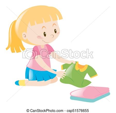 Little girl in pink folding clothes.
