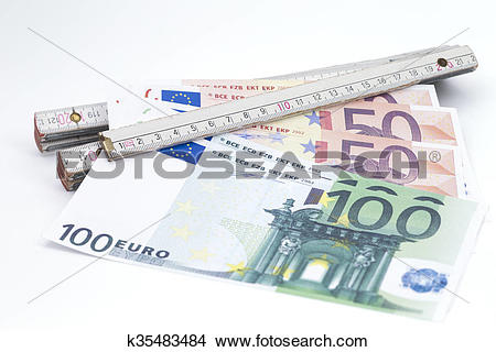Stock Photo of Folding rule with money k35483484.