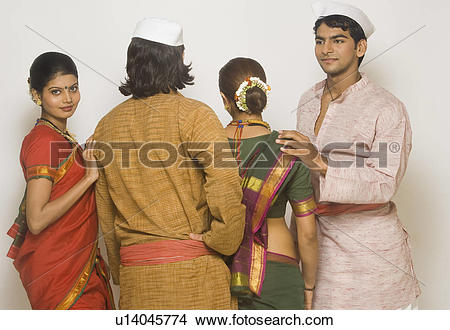 Stock Photo of Folk dancers standing together in traditional.