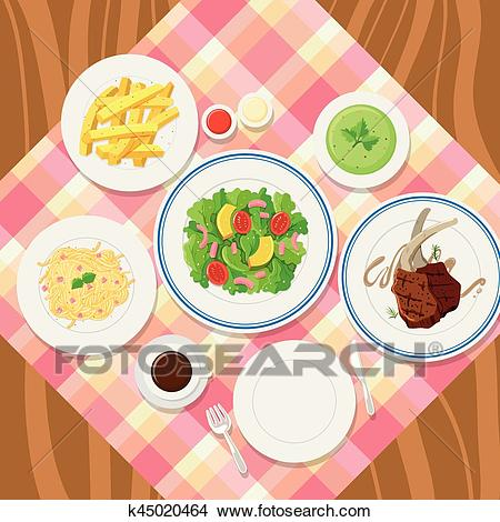 Different plates of food on table Clipart.