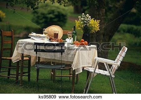 Stock Photograph of Table with food outside ks95809.