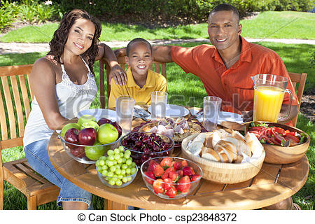 Picture of African American Family Eating Healthy Food Outside.