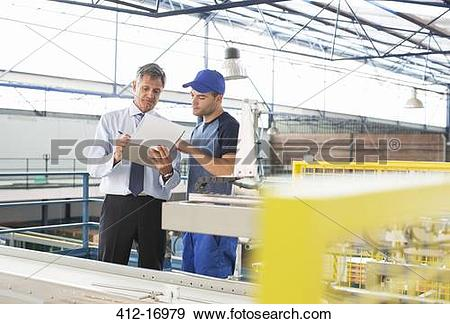 Stock Photograph of Supervisor and worker with clipboard in food.