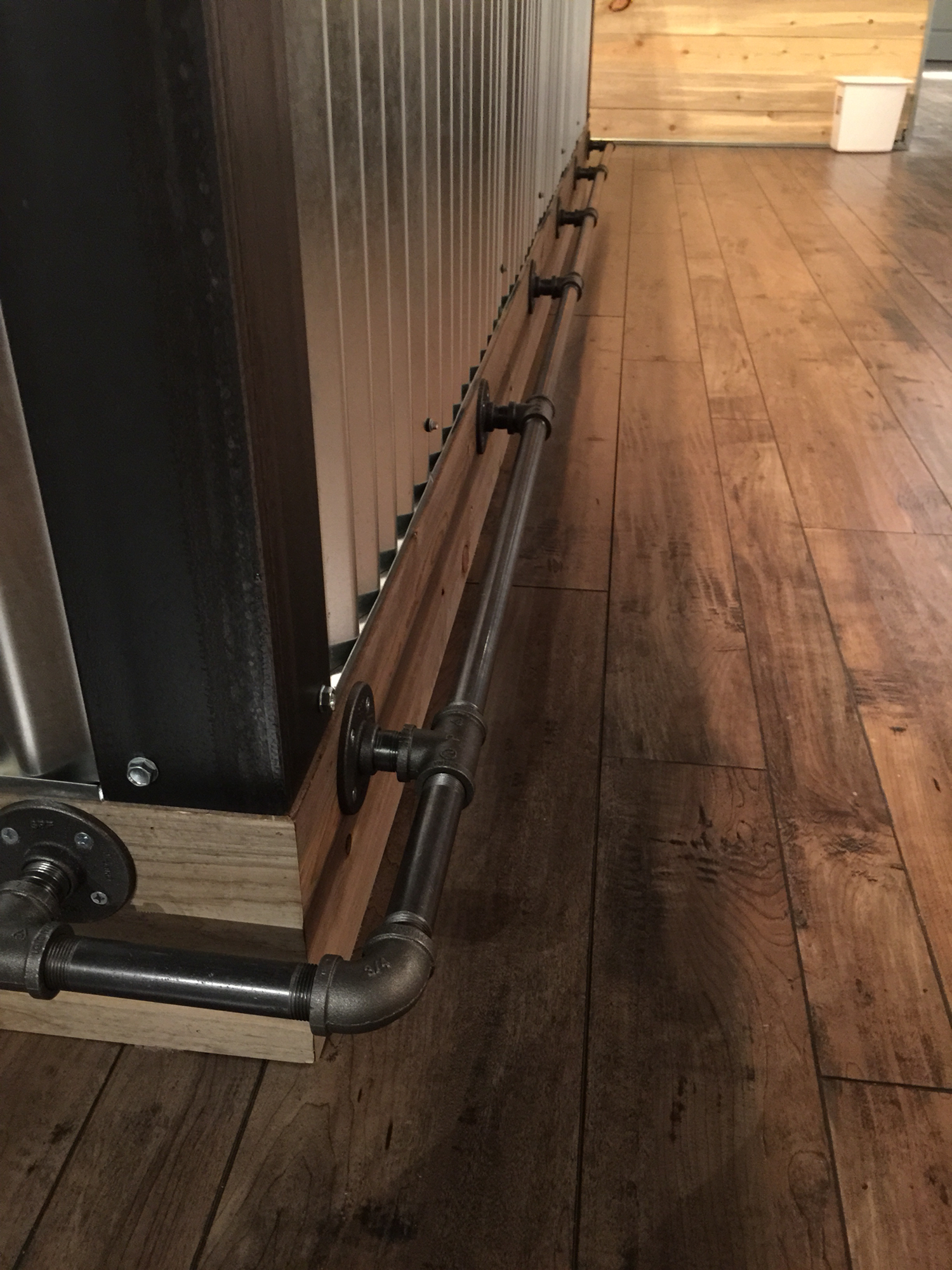 Gas pipe for basement bar foot rest.