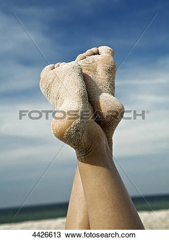 Stock Photo of Sole of foot of a woman at beach 4426613.