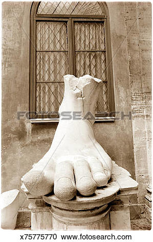 Stock Photography of Sculpture of human foot on podium (B&W sepia.