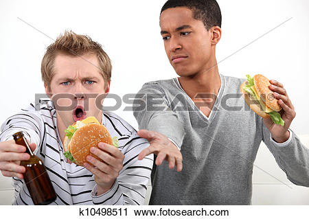 Stock Photography of Friends eating hamburgers and watching a.