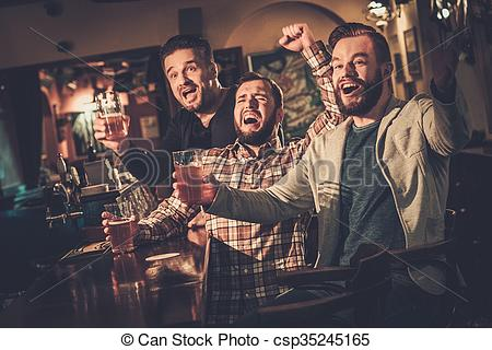 Stock Image of Cheerful old friends having fun watching a football.