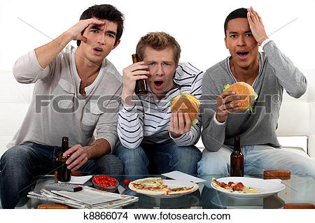 Stock Photo of Group of friends watching a football game k8866074.