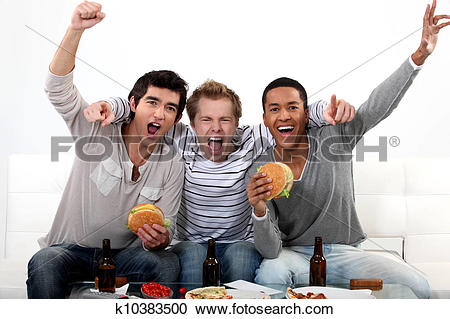 Stock Photography of Friends watching a football game together.