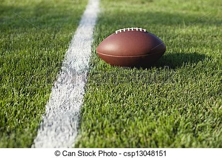 Stock Images of Football on grass field at goal or yard line.