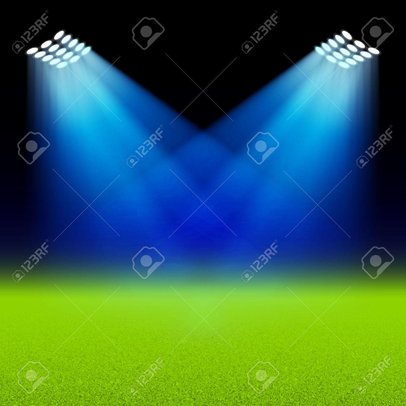 Bright Spotlights Illuminated Green Field Stadium Royalty Free.
