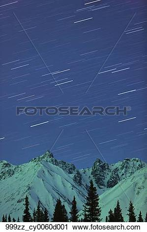 Stock Photography of Northern Lights and star trails above the.