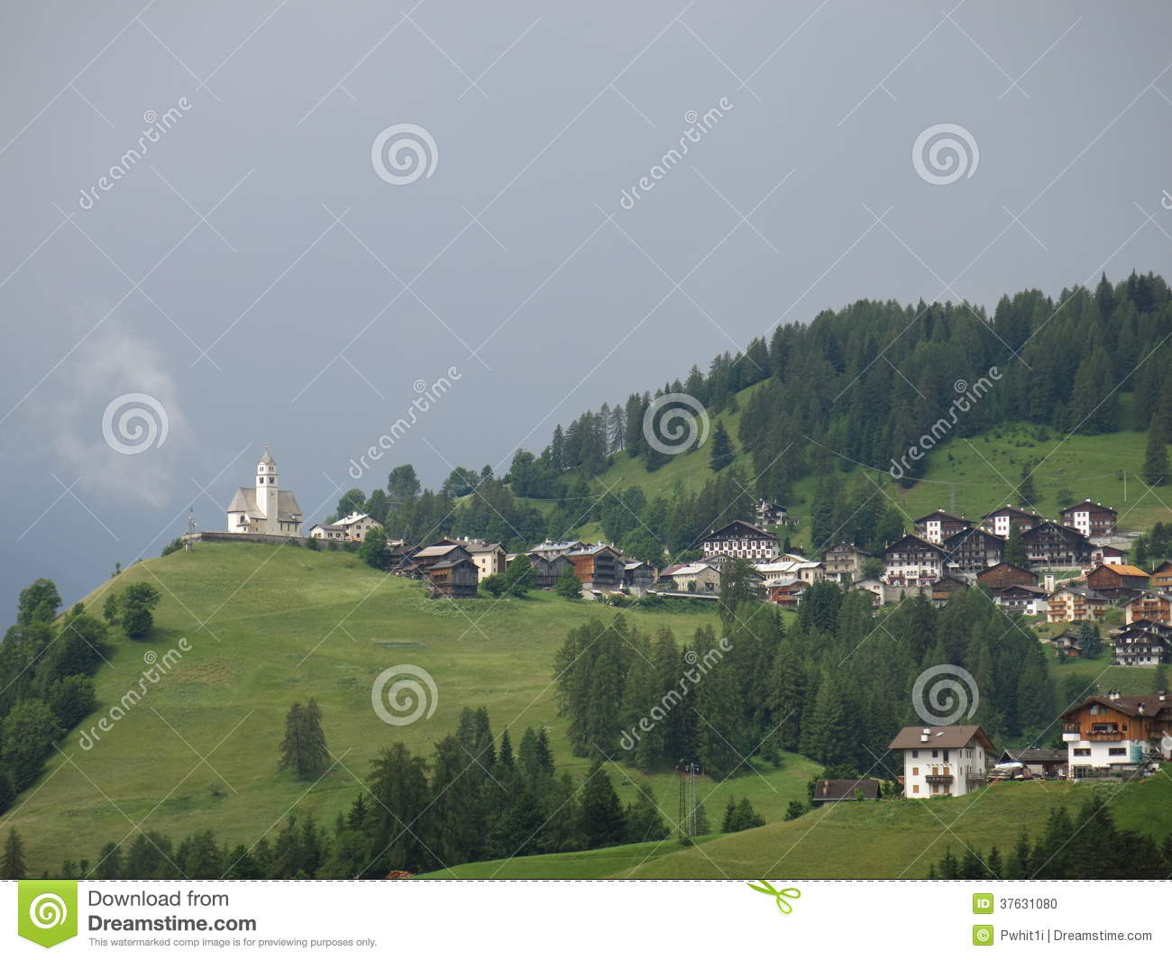 Italian Church And Village In The Foothills Of The Alps Stock.