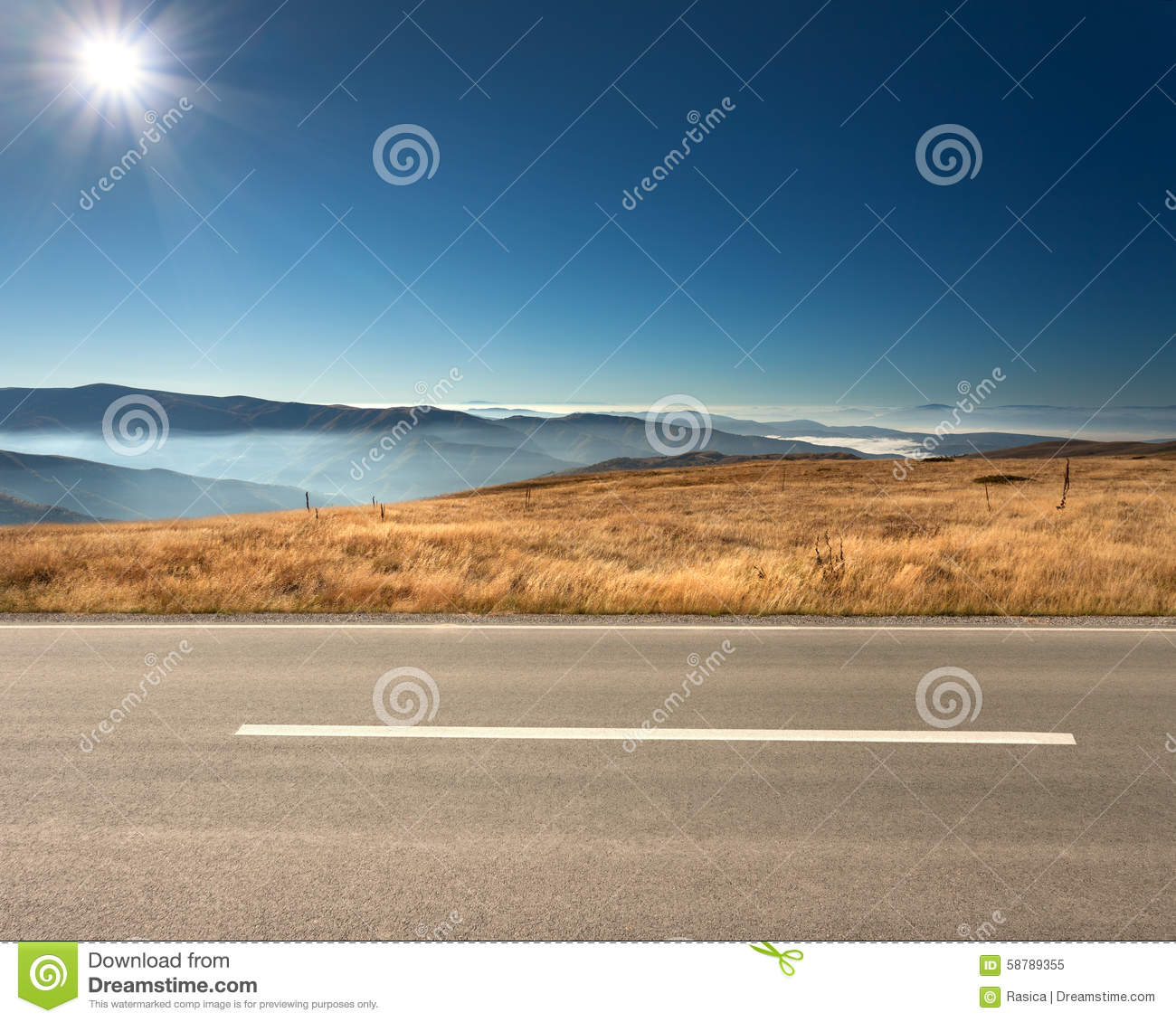 Side View Of Empty Highway In Mountain Range Stock Photo.