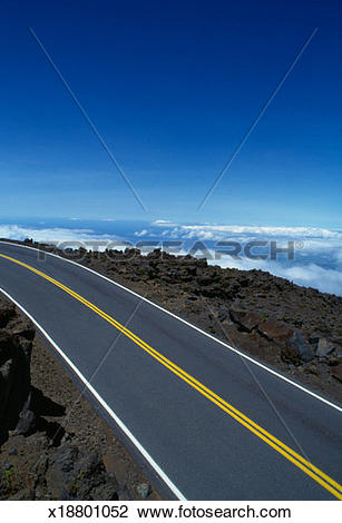 Stock Photo of Empty mountain road above clouds x18801052.