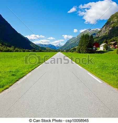 Stock Photo of Straight and empty mountain road.