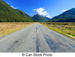 Stock Images of Straight empty road in the mountain, New Zealand.