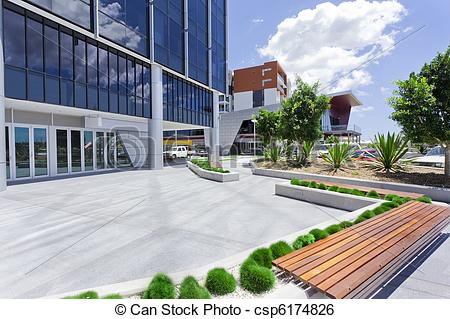 Stock Image of Forecourt of Modern Corporate Building with bench.