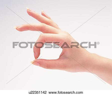 Stock Photo of Woman making a circle with thumb and forefinger.