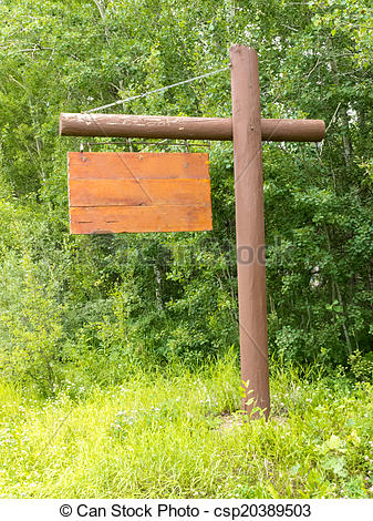 Stock Photography of Empty wooden sign board dense green forest.