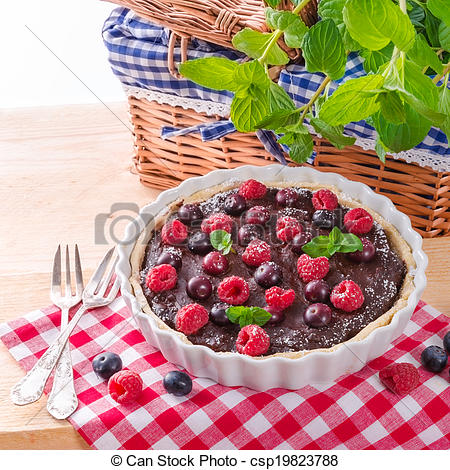 Pictures of chocolate tartelette with forest fruits.