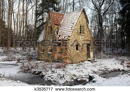 Picture of ruin forest lodge home in winter k3535717.