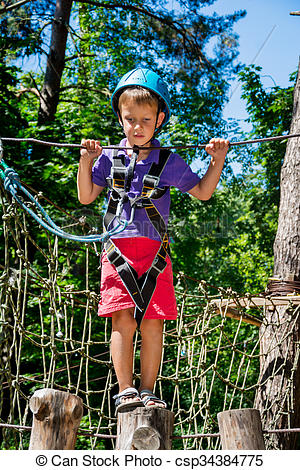 Picture of Five year boy on rope.