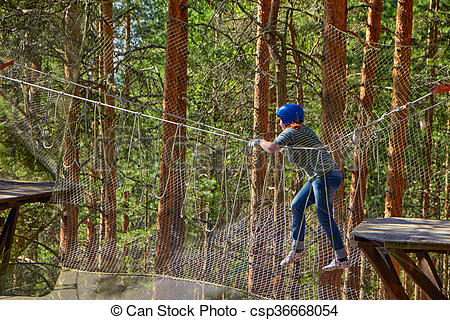 Stock Images of Girl in a Forest Rope Park Challenge.